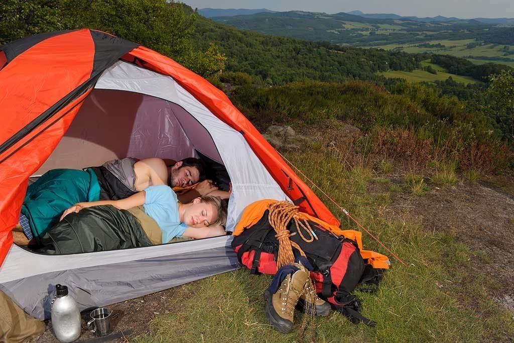 couple sleeping comfortable in a tent