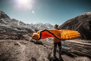man drying his sleeping bag