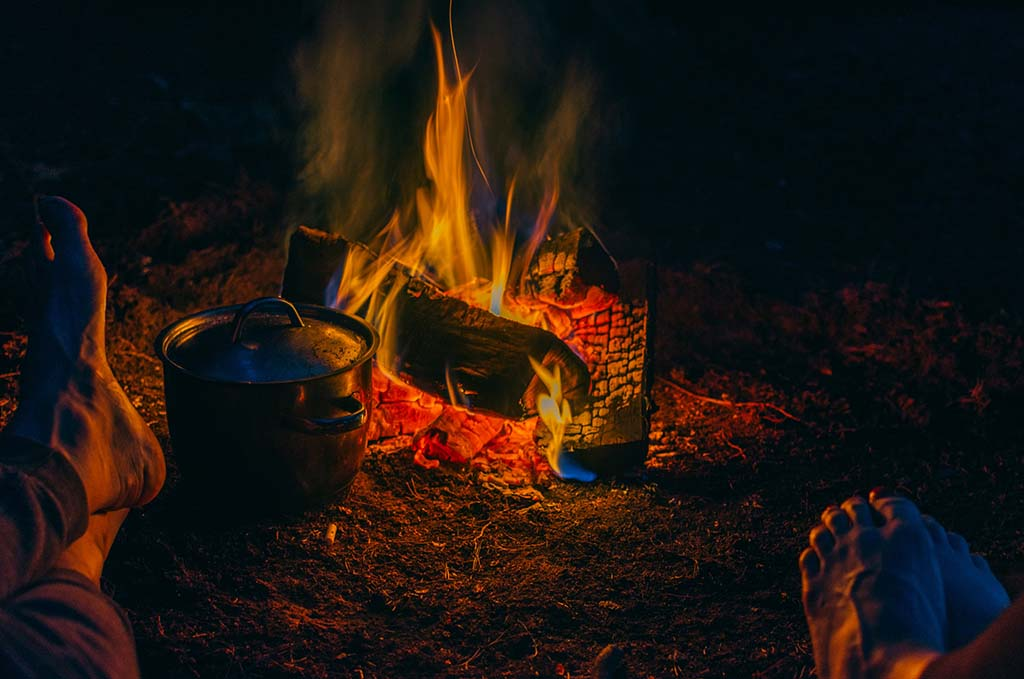 keeping feet warm near a campfire