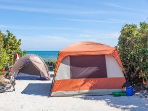 tent with no uv protection pitched on the beach
